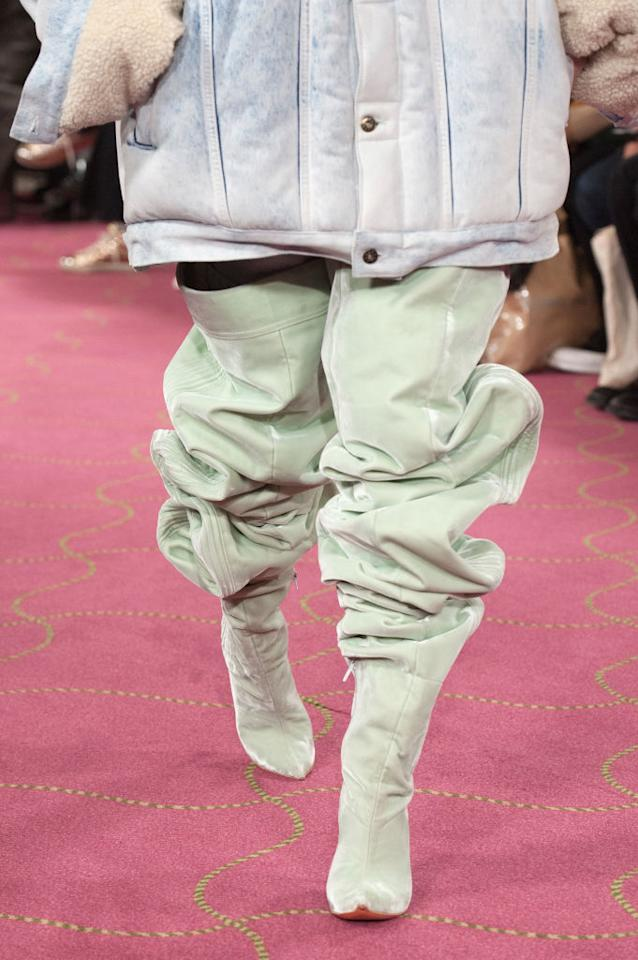 <p>Mint colored Ugg thigh-high boots at the Y/Project FW18 show during Paris Fashion Week.(Photo: Getty) </p>