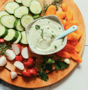 """<p>Anyone will tell ya: Ranch goes on everything. Make your own homemade dressing from soaked cashews, garlic, and maple syrup, among other ingredients. Test which flavors you like the most and put your own spin on a reliable, yet exciting way to upgrade raw veggies. <br><br><a class=""""link rapid-noclick-resp"""" href=""""https://minimalistbaker.com/easy-vegan-ranch-dressing-oil-free/#wprm-recipe-container-38075"""" rel=""""nofollow noopener"""" target=""""_blank"""" data-ylk=""""slk:Get the recipe"""">Get the recipe</a><br><br><em>Per serving: 69 cal, 5.3 g fat (0.91 g saturated fat), 4 g carbs, 0.9 g sugar, 118 mg sodium, 0.4 g fiber, 2.3 g protein</em></p>"""