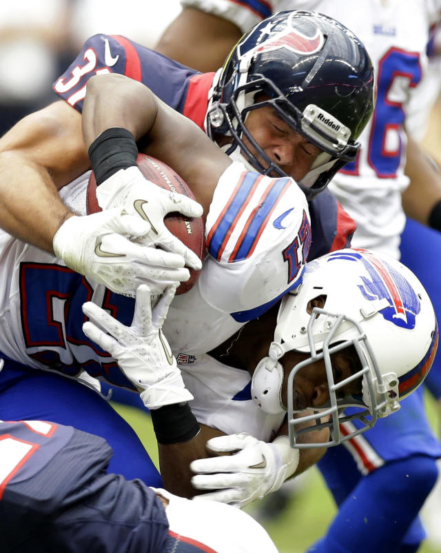 Buffalo Bills cornerback Leodis McKelvin (21) is hit by Houston Texans defensive back Shiloh Keo (31) in the third quarter of an NFL football game on Sunday, Nov. 4, 2012, in Houston. The Texans defeated the Bills 21-9. (AP Photo/Eric Gay)