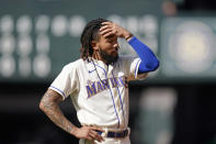 Seattle Mariners' J.P. Crawford stands on the field after he flew out to end the seventh inning of a baseball game against the Arizona Diamondbacks, Sunday, Sept. 12, 2021, in Seattle. (AP Photo/Elaine Thompson)