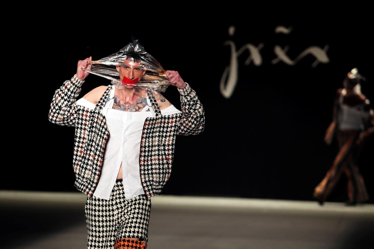A model presents creations from the collection of Joao Pimenta during Sao Paulo Fashion Week in Sao Paulo, Brazil April 24, 2019. REUTERS/Amanda Perobelli