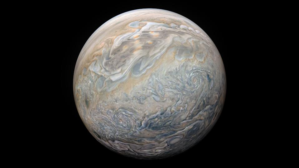 Jupiter looks like a big, swirly space marble in this composite image from NASA's Juno spacecraft. Citizen scientist Kevin Gill processed this image using data collected by Juno during its 23rd close flyby of Jupiter, called a perijove, on Sunday (Nov. 3).