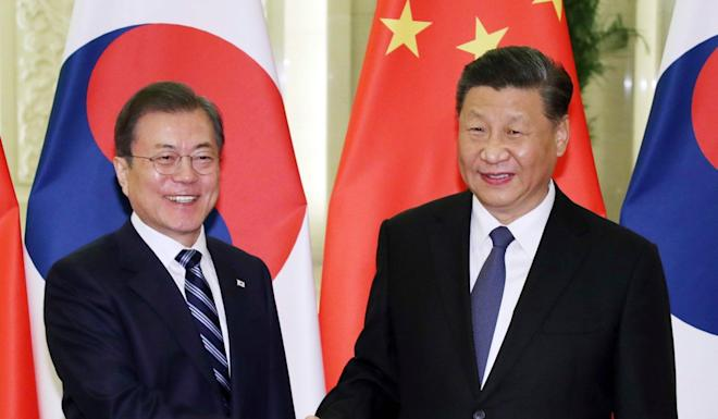 South Korea's President Moon Jae-in, left, and China's President Xi Jinping in Beijing on December 23. Photo: AFP