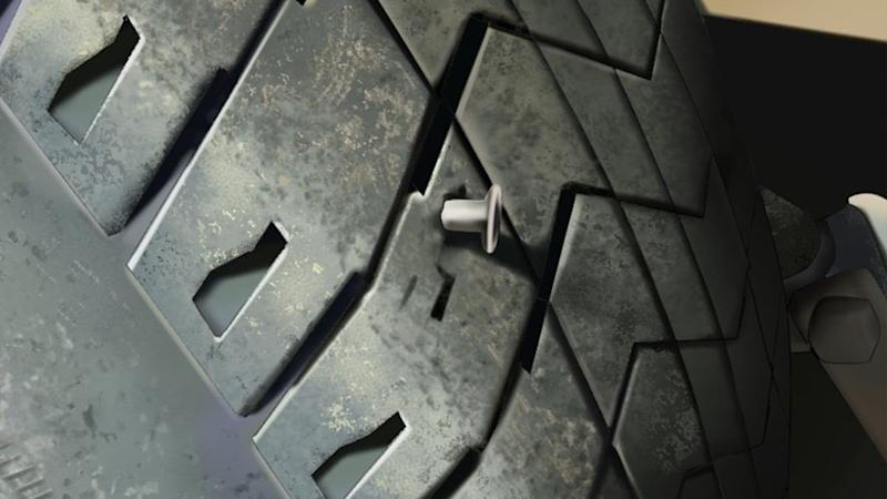 Pictured is the photoshopped image of the nail in a tyre. Source: Twitter