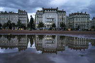 A man wearing a mask walks in the street in the center of Lyon, central France, Wednesday, Oct. 28, 2020. France is bracing for a potential new lockdown as the president prepares a televised address Wednesday aimed at stopping a fast-rising tide of virus patients filling French hospitals and a growing daily death toll. French markets opened lower on expectations that President Emmanuel Macron will announce some kind of lockdown Wednesday. (AP Photo/Laurent Cipriani)