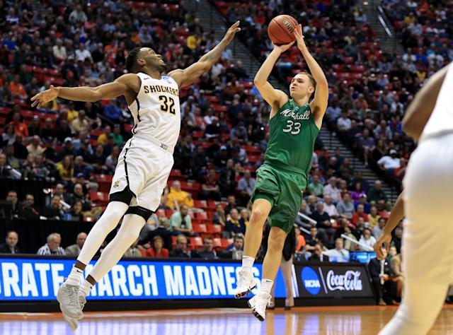 "Marshall's <a class=""link rapid-noclick-resp"" href=""/ncaab/players/127565/"" data-ylk=""slk:Jon Elmore"">Jon Elmore</a> shoots over Wichita State during the Thundering Herd's NCAA tournament upset of the Shockers. (Getty)"