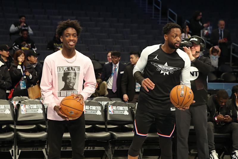 NBA star Dwyane Wade (R) is about to send his 18-year old son Zaire (L) off to college. (Photo by Issac Baldizon/NBAE via Getty Images)