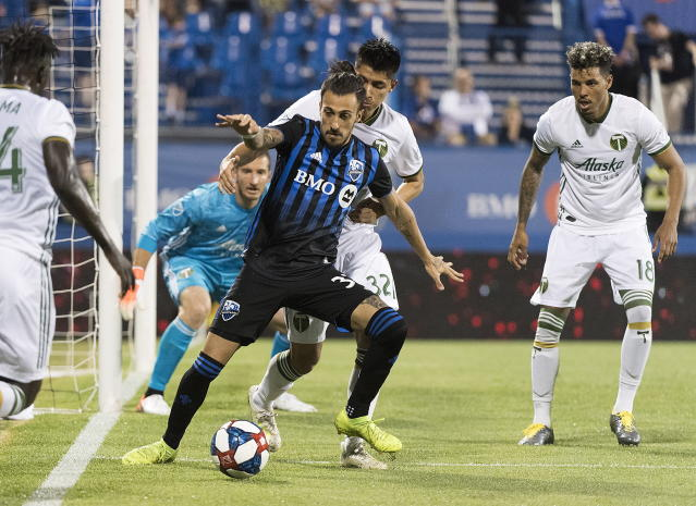 Montreal Impact's Maximiliano Urruti (37) moves in on the Portland Timbers' defense during the second half of an MLS soccer match in Montreal, Wednesday, June 26, 2019. (Graham Hughes/The Canadian Press via AP)