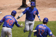 Chicago Cubs' Ian Happ, celebrates his solo home run with Willson Contreras (40) and Kris Bryant (17) in the sixth inning of a baseball game in Detroit, Sunday, May 16, 2021. (AP Photo/Paul Sancya)