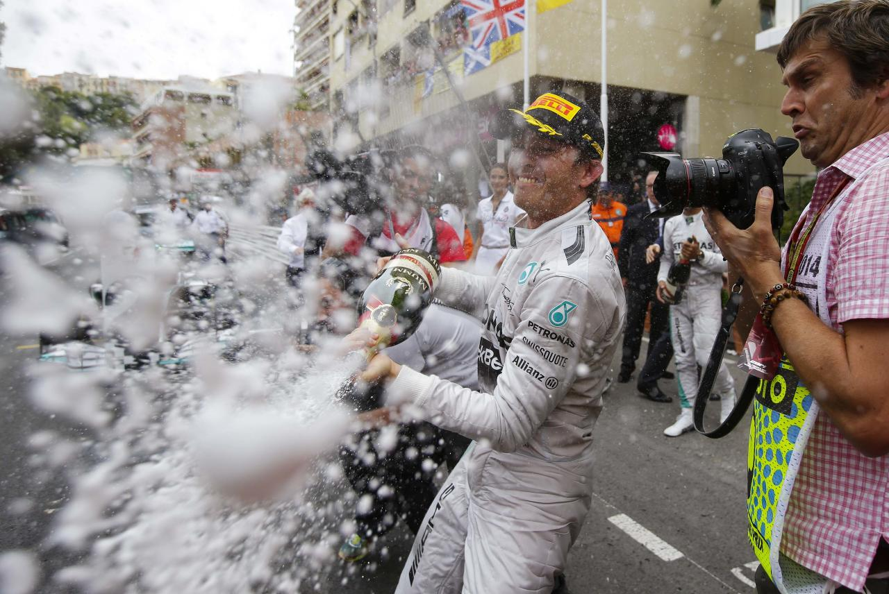 Mercedes Formula One driver Nico Rosberg of Germany sprays champagne after winning the Monaco Grand Prix in Monaco May 25, 2014. REUTERS/Max Rossi (MONACO - Tags: SPORT MOTORSPORT F1)