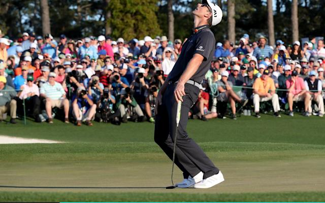 <span>Justin Rose of England reacts to his missed birdie putt on the 18th hole during the final round of the 2017 Masters</span> <span>Credit: Rob Carr/Getty Images </span>