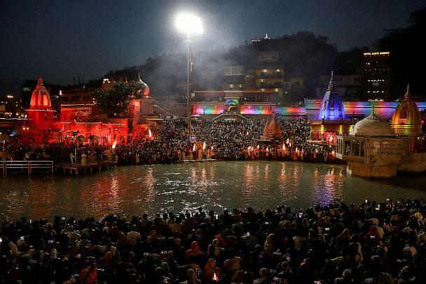 PHOTO: Devotees gather for evening prayer on the banks of the Ganges river during Kumbh Mela (the Pitcher Festival) in Haridwar, India, April 13, 2021. (Anushree Fadnavis/Reuters)
