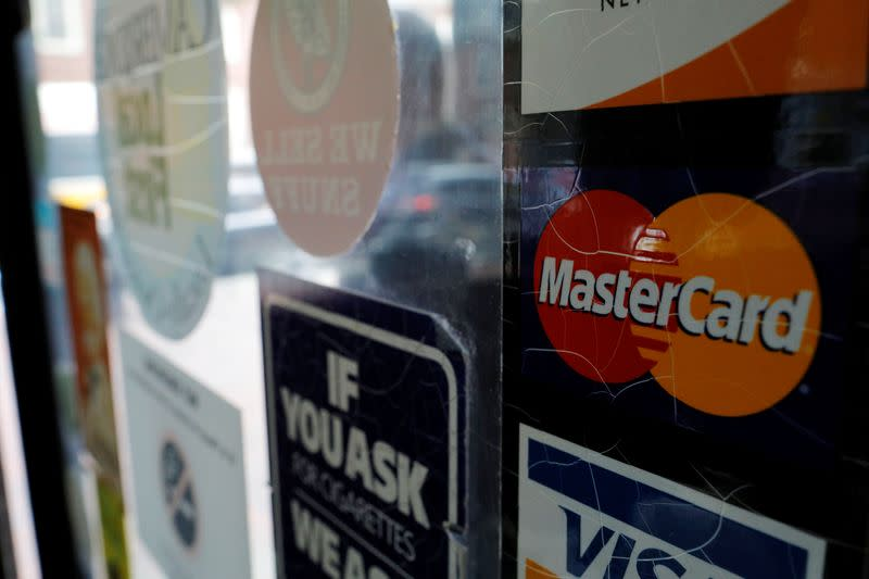 A sticker shows that a store accepts MasterCard in Harvard Square in Cambridge