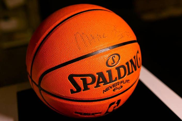 A basketball signed by former NBA player Magic Johnson is on display as part of the exhibit, A Matter of Time: Examining Forty Years of AIDS While Living through a Pandemic, at the Coral Gables Museum in Miami, Florida on Monday, April 5, 2021.