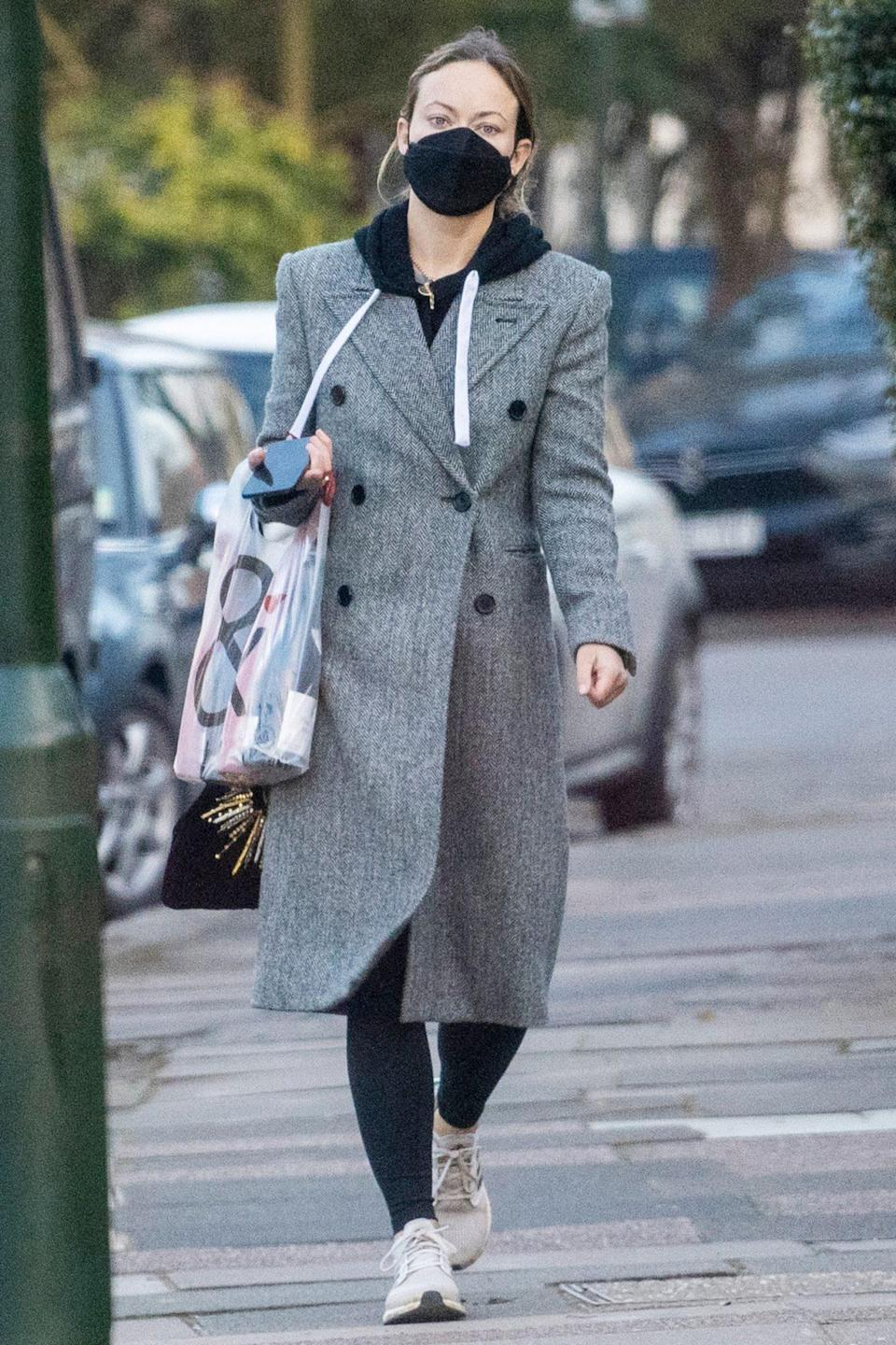 <p>Olivia Wilde picks up some wine in London on Tuesday. </p>