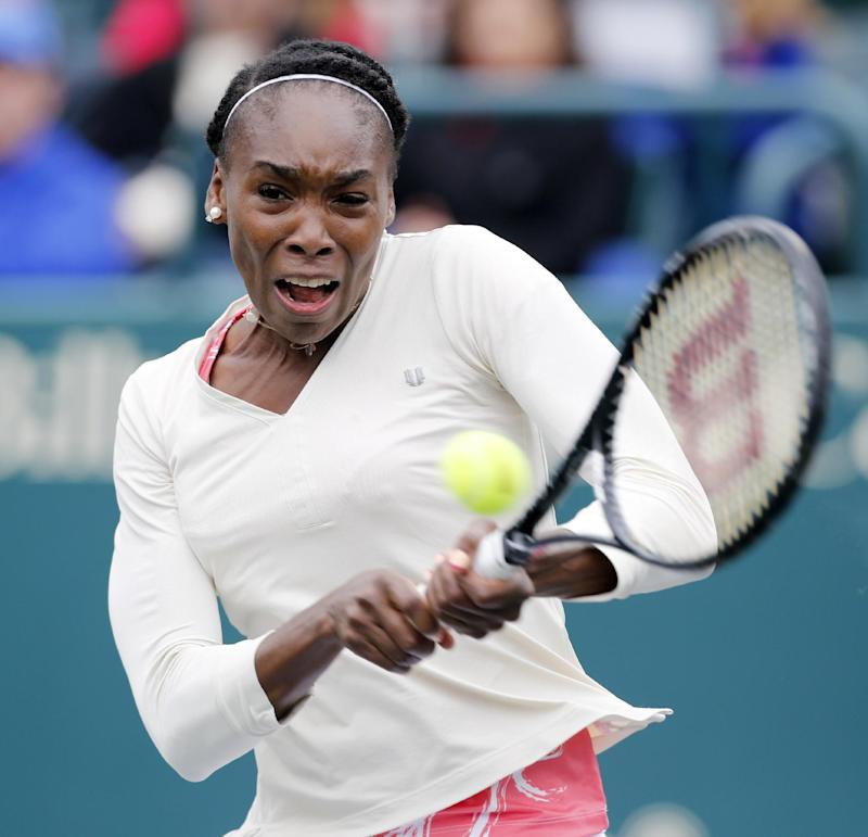 Venus Williams returns to Varvara Lepchenko at the Family Circle Cup tennis tournament in Charleston, S.C., Friday, April 5, 2013.  (AP Photo/Mic Smith)
