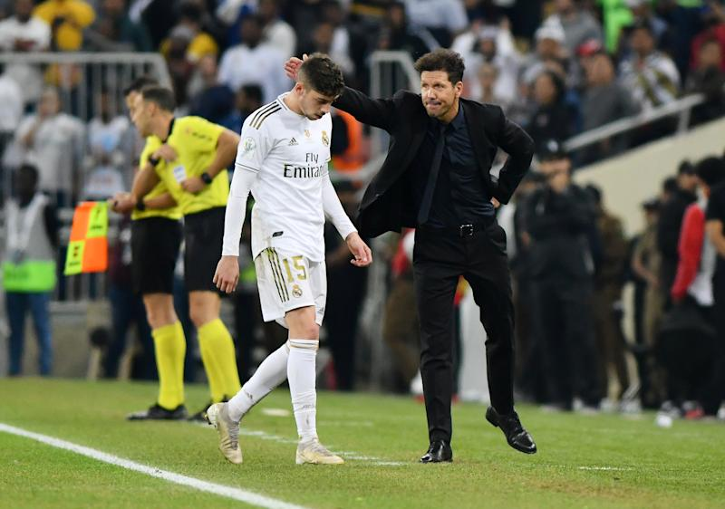 Soccer Football - Spanish Super Cup Final - Real Madrid v Atletico Madrid - King Abdullah Sports City, Jeddah, Saudi Arabia - January 12, 2020 Atletico Madrid coach Diego Simeone with Real Madrid's Federico Valverde who leaves the pitch after being shown a red card by the referee REUTERS/Waleed Ali
