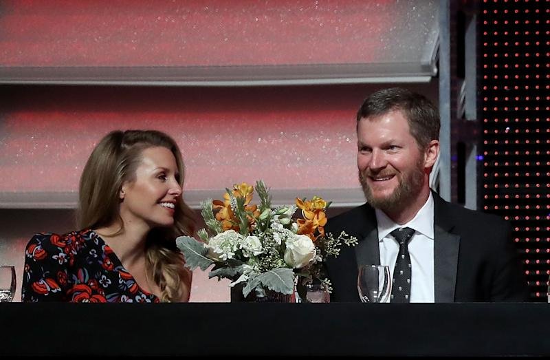 CHARLOTTE, NC - DECEMBER 08: Dale Earnhardt Jr. sits alongside his wife Amy during the NASCAR XFINITY and Truck Series Banquets at Charlotte Convention Center on December 8, 2018 in Charlotte, North Carolina. (Photo by Streeter Lecka/Getty Images)