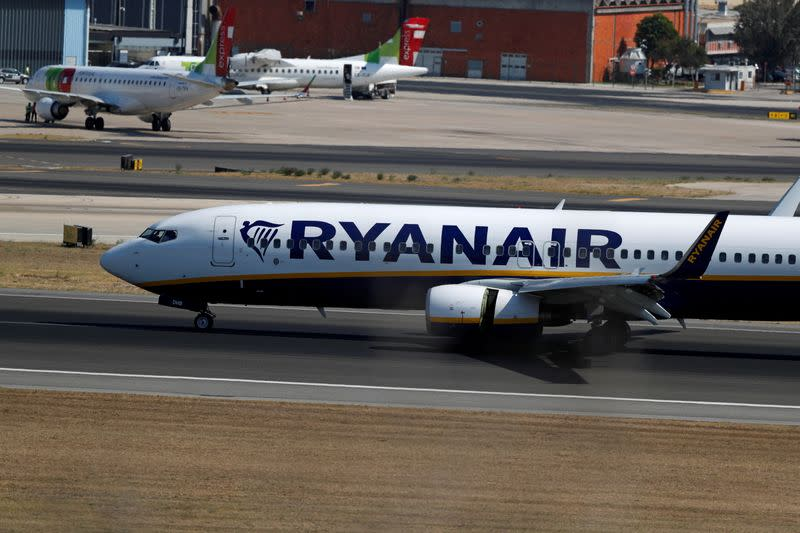 FILE PHOTO: A Ryanair plane taxis at Lisbon's airport