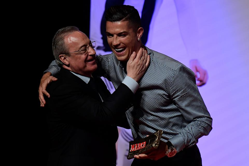 Portugal and Juventus forward Cristiano Ronaldo is congratulated by his former club Real Madrid's president Florentino Perez (L) after receiving the MARCA Leyenda (MARCA Legend) award in Madrid on July 29, 2019. - The award is attributed to sport professionals by the Spanish sports newspaper MARCA. (Photo by JAVIER SORIANO / AFP)        (Photo credit should read JAVIER SORIANO/AFP via Getty Images)