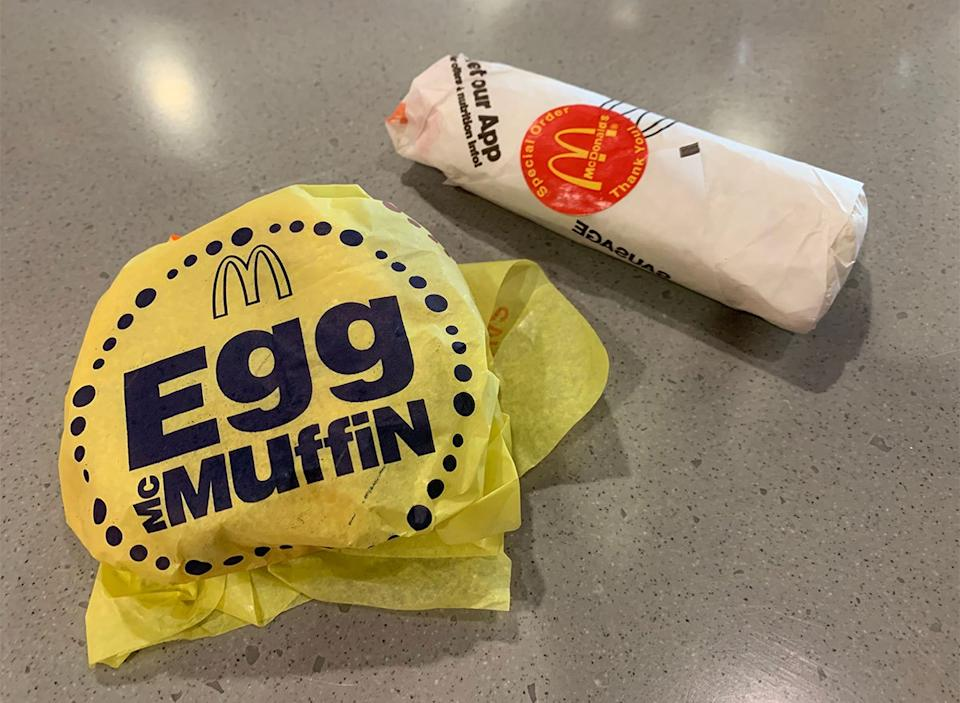 mcdonalds egg mcmuffin and breakfast burrito in wrappers