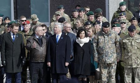 (L-R) Estonia's Defence Minister Margus Tsahkna his Denmark's counterpart Claus Hjort Frederiksenand Britain's Defence Secretary Michael Fallon attend the official ceremony welcoming the deployment of a multi-national NATO battalion in Tapa, Estonia, April 20, 2017. REUTERS/Ints Kalnins