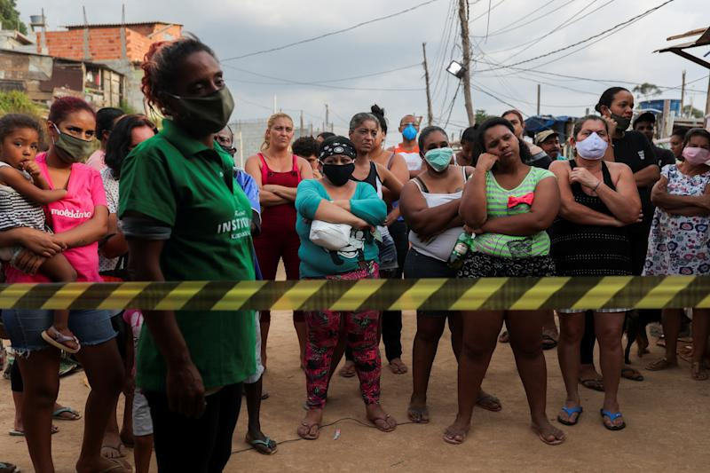 Residents wait for food donations organized by NGO Kapadocia Institute for poor families from Capadocia Slum at Brasilandia district amid the coronavirus disease (COVID-19) outbreak, in Sao Paulo, Brazil, May 1, 2020.REUTERS/Amanda Perobelli