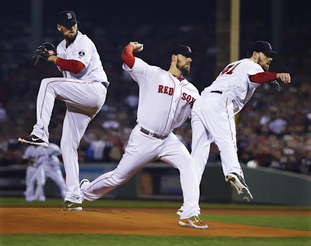 In a multiple exposure, Boston Red Sox starting pitcher John Lackey throws during the first inning of Game 6 of baseball's World Series against the St. Louis Cardinals Wednesday, Oct. 30, 2013, in Boston. (AP Photo/Matt Slocum)