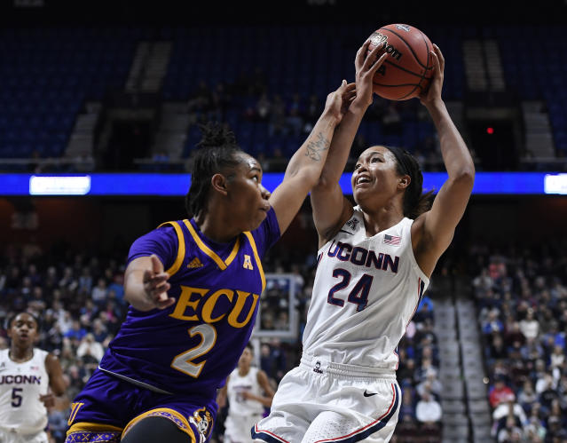 Connecticut's Napheesa Collier, right, is fouled by East Carolina's c during the first half of an NCAA college basketball game in the American Athletic Conference tournament quarterfinals, Saturday, March 9, 2019, at Mohegan Sun Arena in Uncasville, Conn. (AP Photo/Jessica Hill)