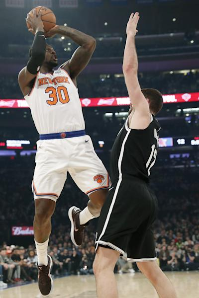 New York Knicks forward Julius Randle (30) attempts a three-point shot over Brooklyn Nets forward Joe Harris (12) during the first half of an NBA basketball game in New York, Sunday, Jan. 26, 2020. (AP Photo/Kathy Willens)