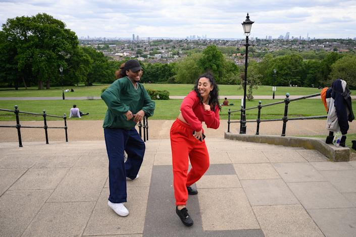 LONDON, UNITED KINGDOM - MAY 13: Two dancers take the opportunity to practise in the fresh air of Alexandra Park, as some aspects of the lockdown are eased, on May 13, 2020 in London, England. The prime minister announced the general contours of a phased exit from the current lockdown, adopted nearly two months ago in an effort curb the spread of Covid-19. (Photo by Leon Neal/Getty Images)