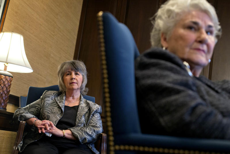 Susan Harrison, 63, of Lawrenceville, Ga., left, and Vea Gaby, 73, of Athens, right, listen to Lynn Waits, 55, of Covington, Ga., not pictured, tell her story during an interview about complications from having surgical mesh placed in her pelvic cavity, in their attorney's office, Monday, Jan. 28, 2013, in Athens, Ga. The Georgia women are some of the thousands of women nationwide who have sued manufacturers of the surgical mesh claiming they've suffered severe complications and intense physical pain when the flexible plastic mesh hardened inside their bodies. (AP Photo/David Goldman)
