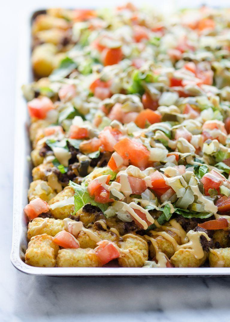 """<p>Your kids will love these tater tot nachos that are smothered in delicious cheeseburger toppings. </p><p><strong><a href=""""https://www.thepioneerwoman.com/food-cooking/recipes/a96614/cheeseburger-totchos/"""" rel=""""nofollow noopener"""" target=""""_blank"""" data-ylk=""""slk:Get the recipe."""" class=""""link rapid-noclick-resp"""">Get the recipe.</a> </strong></p><p><strong><a class=""""link rapid-noclick-resp"""" href=""""https://go.redirectingat.com?id=74968X1596630&url=https%3A%2F%2Fwww.walmart.com%2Fbrowse%2Fhome%2Fthe-pioneer-woman-plates%2F4044_623679_639999_2113437_9360029&sref=https%3A%2F%2Fwww.thepioneerwoman.com%2Ffood-cooking%2Fmeals-menus%2Fg35049189%2Fsuper-bowl-food-recipes%2F"""" rel=""""nofollow noopener"""" target=""""_blank"""" data-ylk=""""slk:SHOP PLATES"""">SHOP PLATES</a><br></strong></p>"""