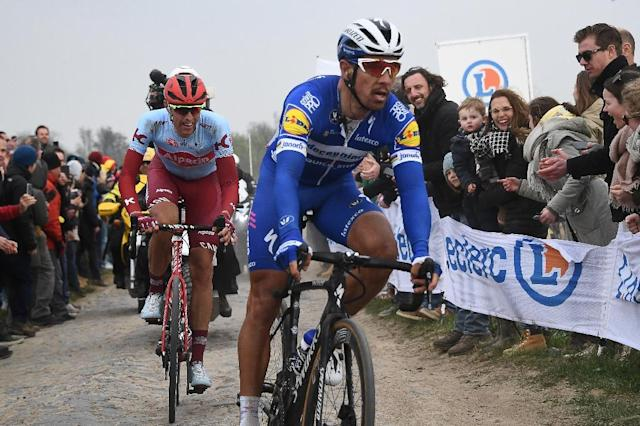 Belgium's Philippe Gilbert on his way to victory at Paris-Roubaix (AFP Photo/Anne-Christine POUJOULAT)