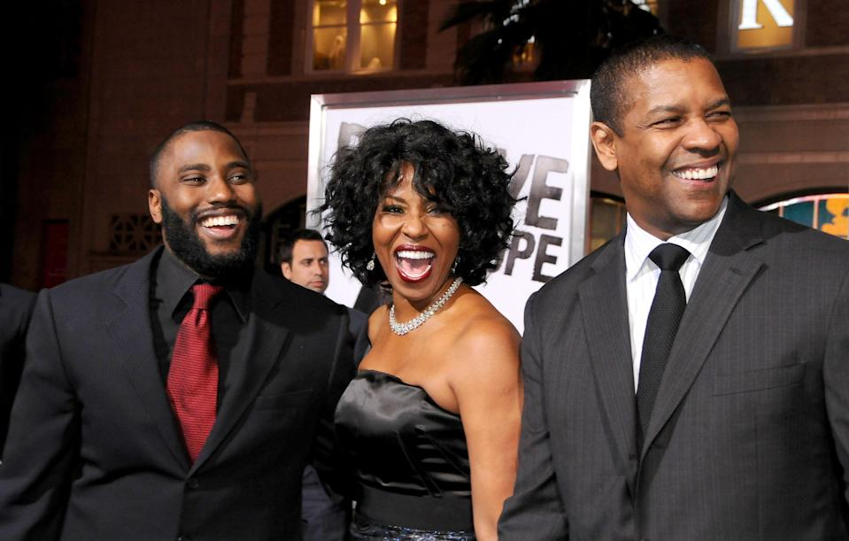 John David Washington with his parents, Pauletta Washington and Denzel Washington, at <em>The Book Of Eli </em>premiere in January. (Photo: Gregg DeGuire/FilmMagic)