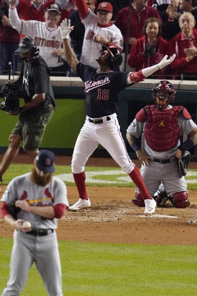 Washington Nationals' Victor Robles reacts as he crosses home after hitting a home run during the sixth inning of Game 3 of the baseball National League Championship Series against the St. Louis Cardinals Monday, Oct. 14, 2019, in Washington. (AP Photo/Alex Brandon)
