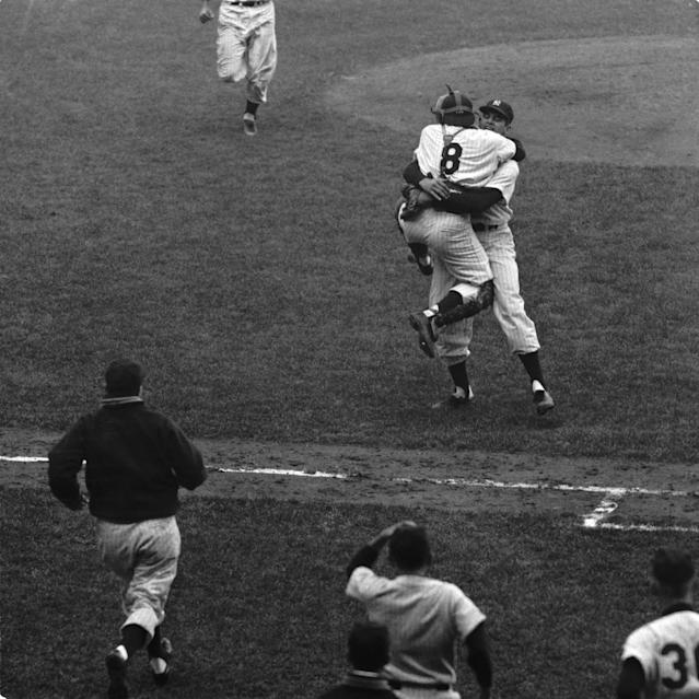 Don Larsen wraps his arms around catcher Yogi Berra after the final pitch of Game 5 of the 1956 World Series against the Brooklyn Dodgers at Yankee Stadium in New York. Larsen pitched the first perfect game in World Series history as the Yankees defeated the Dodgers, 2-0. (Diamond Images/Getty Images)