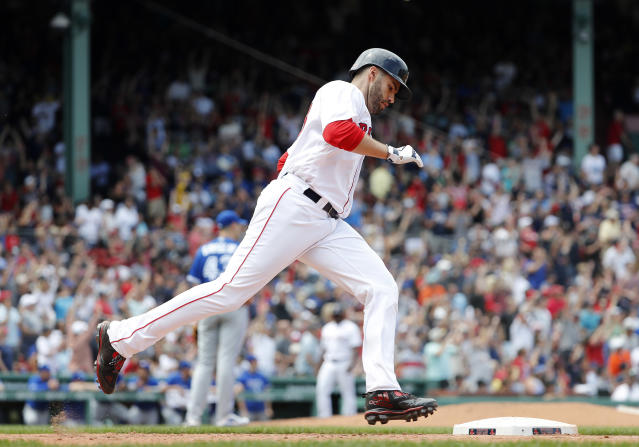 Boston Red Sox's J.D. Martinez rounds the bases after his home run against the Toronto Blue Jays during the fourth inning of a baseball game Saturday, July 14, 2018, in Boston. (AP Photo/Winslow Townson)