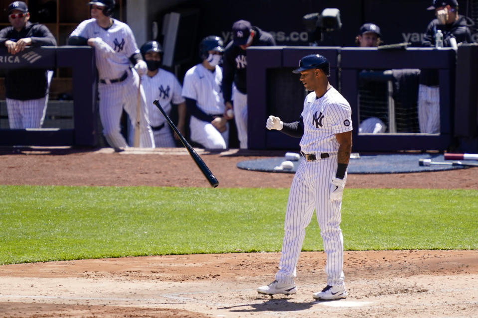 New York Yankees' Aaron Hicks flips his bat as he strikes out against Detroit Tigers starting pitcher Spencer Turnbull with bases loaded in the third inning of a baseball game, Saturday, May 1, 2021, in New York. (AP Photo/John Minchillo)