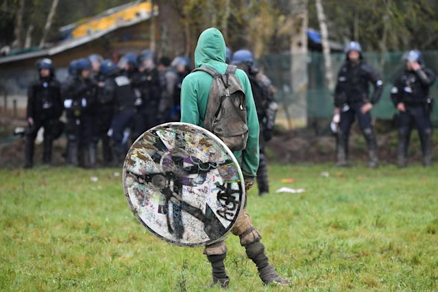 <p>Protesters clash with French anti-riot gendarmes during an operation to clear an area known as ZAD (Zone a Defendre – Zone to defend) of environmental protesters occupying the site of what had been a proposed new airport in Notre dame des Landes on April 10, 2018. (Photo: Loic Venance/AFP/Getty Images) </p>