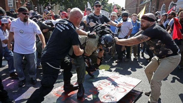 PHOTO: White nationalists, neo-Nazis, the KKK and members of the 'alt-right' clash with counter-protesters outside Emancipation Park during the Unite the Right rally Aug. 12, 2017 in Charlottesville, Va. (Chip Somodevilla/Getty Images)