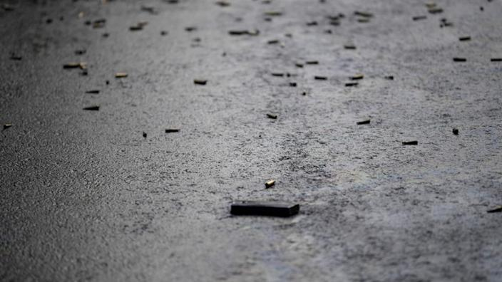 Dozens of bullet encasings littered the tarmac after the attack