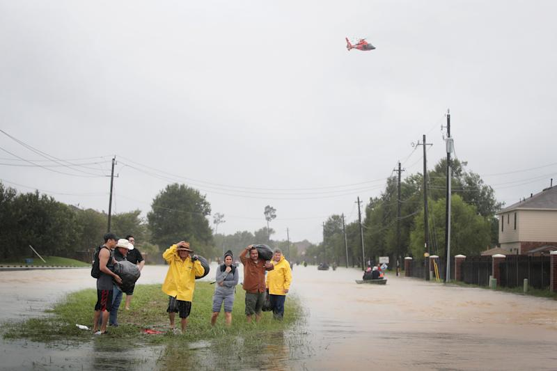Residentsmake their way out of a flooded neighborhood in Houston on Monday. President Donald Trump has officially requested Congress approve $7.85 billion for relief efforts in Texas and Louisiana. (Scott Olson/Getty Images)
