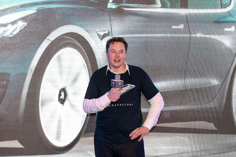 "Tesla CEO Elon Musk speaks during the Tesla China-made Model 3 Delivery Ceremony in Shanghai. - Tesla CEO Elon Musk presented the first batch of made-in-China cars to ordinary buyers on January 7, 2020 in a milestone for the company's new Shanghai ""giga-factory"", but which comes as sales decelerate in the world's largest electric-vehicle market. (Photo by STR / AFP) / China OUT (Photo by STR/AFP via Getty Images)"