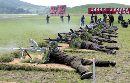 A live bullet firing demonstration is held by service personnel from the Korean People's Army in South Hwanghae Province. REUTERS/KCNA