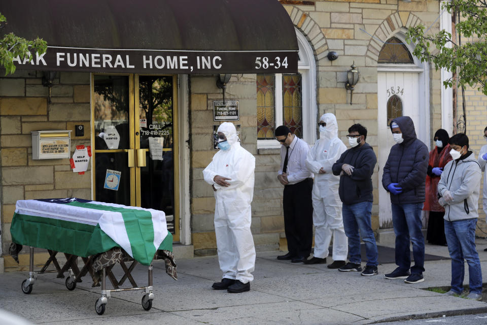 FILE - In this April 22, 2020, file photo, mourners pray as the remains of Traffic Section Commander Mohammed Chowdhury are brought out of the funeral home during his funeral in New York. Chowdhury died on April 19, 2020, from complications related to the coronavirus. Whether it's framed as American exceptionalism, American interventionism, American global standing, or a lack of it, how the world's foremost superpower moves forward following the presidential election will have a sizeable impact in various geopolitical pressure points and in the time of the pandemic. (AP Photo/Seth Wenig, File)