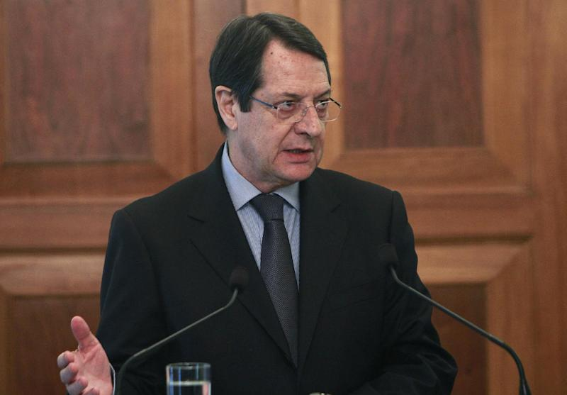 Cyprus' President Nicos Anastasiades, talks during the oath of office ceremony of a new Finance Minister Harris Georgiades, unseen, at the Presidential Palace the Cypriot capital Nicosia, on Wednesday, April 3, 2013. Georgiades, 41, takes over from Michalis Sarris who resigned on Tuesday as an investigating committee began work to determine how the country's economy nearly collapsed. (AP Photo/Petros Karadjias)