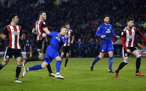 """Neil Warnock's comeback to his beloved Bramall Lane ended in a fairytale finish, as one of his Cardiff City substitutes – Anthony Pilkington – rescued a point in injury time. Although Warnock's Cardiff endured their eight-game winning run being ended, the exuberant celebrations after the equaliser showed what this meant, as they demonstrated the fighting spirit that has muscled them into the top two. Warnock said his players looked like they had """"won the World Cup"""" when they came into the dressing room at full-time. It was all so hard to take for play-off chasing Sheffield United – a club that Warnock famously both supported and managed – after their impressive display. Watching the late Cardiff joy clearly hurt them. United manager Chris Wilder said afterwards that his men had been accused of being """"smug"""" by opposition staff, """"but that wasn't our attitude"""", indicating some lingering ill-feeling. Ultimately, United were not clinical, while Cardiff were, and that is a key difference between the clubs. Warnock, beaming with pride when he came in to his press conference. """"It could be the best point of the season that, in the circumstances,"""" he said. """"You never say never with our lot. Cloughie [Brian Clough] used to say it only takes a second to score a goal."""" Warnock also gave a reminder of old times by criticising the officials, adding: """"I thought he might have booked a couple of ball boys, too [for slowing the game down] - but they learned from me maybe."""" Anthony Pilkington grabs Cardiff's late equaliser Credit: Richard Sellers/PA Ball boys aside, nothing could dampen Warnock's enthusiasm after a timely result – with Wolves and Aston Villa being Cardiff's next opponents. Wilder's men had automatic promotion dreams of their own in the first half of the season – until Leon Clarke stopped scoring goals so prolifically. Perhaps it is a promising omen that the striker ended his 10-game drought here. The problem was that Clarke's strike was all that they had to show for th"""
