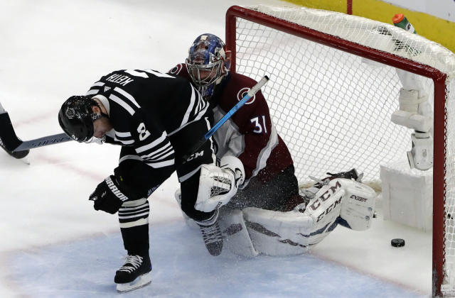 Chicago Blackhawks defenseman Duncan Keith, left, scores the game-winning goal against Colorado Avalanche goalie Philipp Grubauer during overtime in an NHL hockey game Sunday, March 24, 2019, in Chicago. The Blackhawks won 2-1. (AP Photo/Nam Y. Huh)