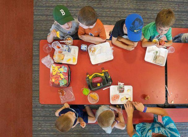 PHOTO: Children in a summer program eat lunch at a cafeteria in Buxton, Maine, July 12, 2018. (Press Herald via Getty Images, FILE)